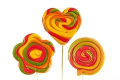 Tres lollipops coloridos Imagen de archivo libre de regalías
