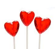 Tres lollipops en forma de corazón para la tarjeta del día de San Valentín Imagen de archivo libre de regalías
