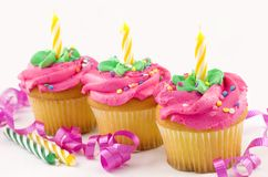 Tres magdalenas del cumpleaños Imágenes de archivo libres de regalías