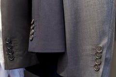 Tres mangas del traje de los hombres Foto de archivo