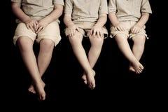 Tres manos y pies de los cabritos Fotografía de archivo