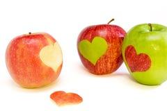 Tres manzanas con los corazones Fotos de archivo libres de regalías