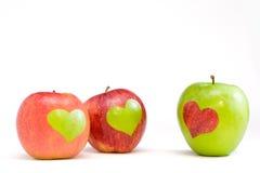 Tres manzanas con los corazones Imagen de archivo libre de regalías