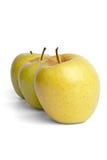 Tres manzanas del oro Imágenes de archivo libres de regalías