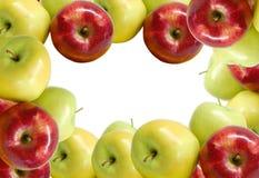 Tres manzanas en una placa Foto de archivo