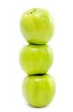 Tres manzanas verdes Foto de archivo