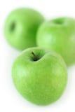 Tres manzanas verdes jugosas Imagen de archivo libre de regalías