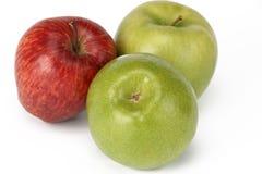 Tres manzanas, verdes y rojos Imagenes de archivo