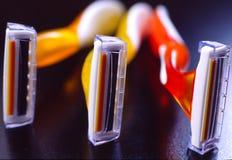 Tres maquinillas de afeitar Imagen de archivo