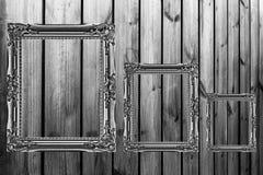 tres marcos de madera en fondo de madera Imagenes de archivo