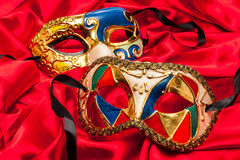Tres Mardi Gras Masks en la seda roja Imagen de archivo