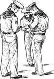 Tres marineros con los teléfonos celulares Imagenes de archivo