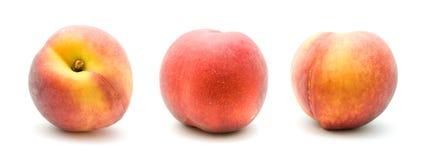 Tres melocotones rojos maduros Foto de archivo