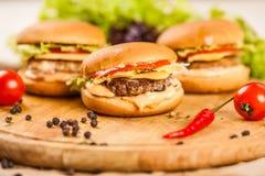Tres mini hamburguesas Imagen de archivo libre de regalías