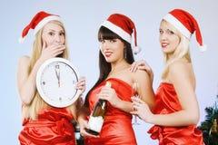 Tres muchachas bastante atractivas Imagenes de archivo