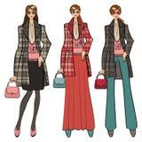 Tres muchachas de moda preciosas Forme la ilustración Fotografía de archivo libre de regalías