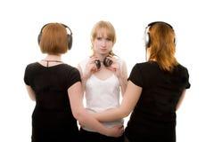 Tres muchachas en auriculares Fotografía de archivo libre de regalías