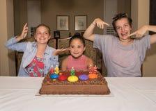 Tres muchachas que celebran sus cumpleaños Imagen de archivo libre de regalías