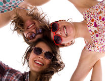 Tres muchachas que ensamblan junto Foto de archivo libre de regalías