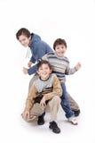 Tres muchachos y maneras Fotografía de archivo