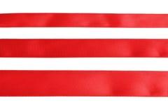 Tres muestras de cinta roja del paño Imagen de archivo