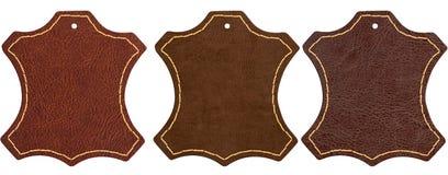Tres muestras de cuero marrones en el fondo blanco imagenes de archivo