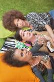 Tres mujeres borrachas en piso Fotos de archivo libres de regalías