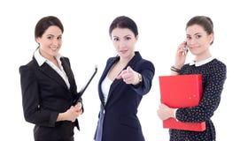 Tres mujeres de negocios jovenes que señalaban en usted aislaron en blanco Imagen de archivo