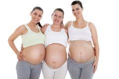 Tres mujeres embarazadas de la felicidad Foto de archivo libre de regalías