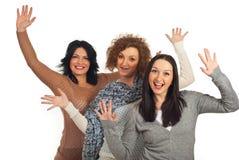 Tres mujeres emocionadas con los brazos para arriba Fotografía de archivo libre de regalías