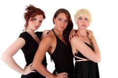 Tres mujeres ennegrecen las alineadas Imagenes de archivo