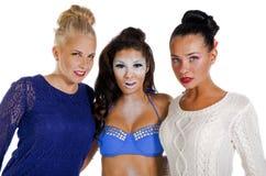 Tres mujeres hermosas aisladas en blanco Fotos de archivo libres de regalías