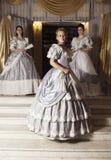 Tres mujeres jovenes en vestidos de bola Foto de archivo libre de regalías