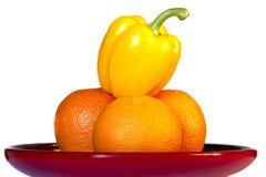 Tres naranjas y pimientas Imágenes de archivo libres de regalías