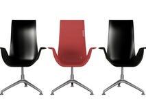 Tres negros y butacas rojas de la oficina aisladas Imagen de archivo libre de regalías