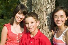 Tres niños imagen de archivo