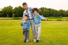 Tres niños agradables imagen de archivo