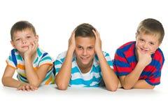 Tres niños con diversas emociones Imágenes de archivo libres de regalías