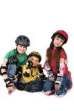Tres niños en cascos Imagenes de archivo