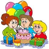 Tres niños en la fiesta de cumpleaños Foto de archivo
