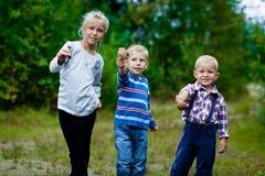 Tres niños felices Foto de archivo libre de regalías