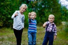 Tres niños felices Foto de archivo