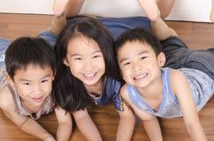 Tres niños felices Fotos de archivo libres de regalías