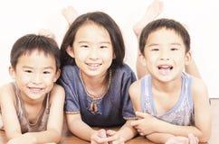 Tres niños felices Fotografía de archivo libre de regalías