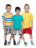 Tres niños pequeños sonrientes de la moda Imagen de archivo libre de regalías
