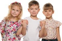 Tres niños serios Imagen de archivo