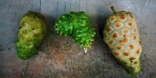 Tres Noni Fruits imagen de archivo