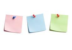 Tres notas pegajosas sobre blanco Fotos de archivo libres de regalías