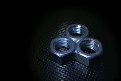 Tres nueces en fondo del carbono Imagen de archivo