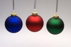 Tres ornamentos de la Navidad Imagen de archivo libre de regalías